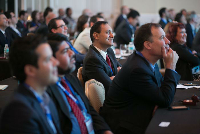 The attendees engaged in lively discussion with the guest speakers throughout day one.