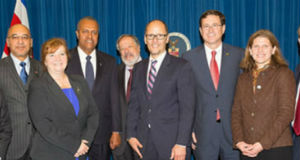 US Labor Department officials flanked by ambassadors from Latin American countries.