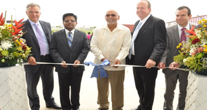 NSAM's Kirk Laughlin, Finance Minister Dr. Ashni Singh, President Donald Ramotar, Qualfon CEO Mike Marrow and Qualfon Founder Alfonso Gonzalez participated in the ribbon-cutting ceremony at Qualfon's new campus in Guyana.